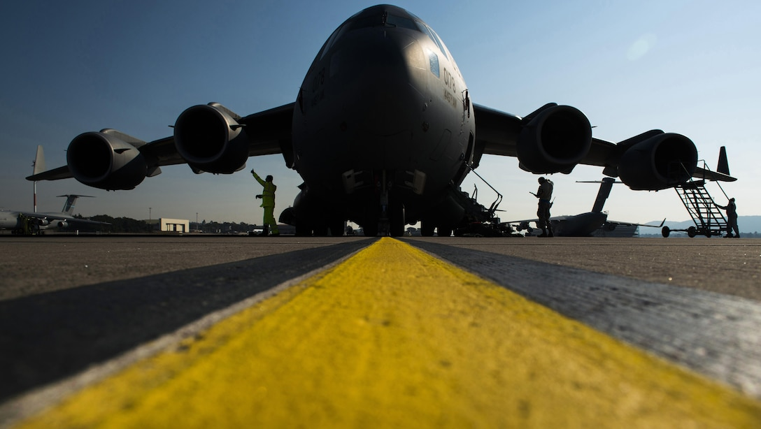 Airmen from the 452nd Maintenance Squadron perform a routine inspection of a C-17 Globemaster III Sept. 22, 2016 at Ramstein Air Base, Germany. Airmen from the 452nd MXS worked with the 721st Aircraft Maintenance Squadron while at Ramstein for a temporary duty. Every aircraft flying in and out of Ramstein undergoes an inspection to ensure nothing has broken or malfunctioned. (U.S. Air Force photo/Senior Airman Tryphena Mayhugh)