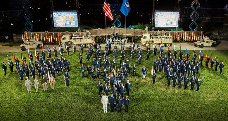 Joint service members stand for a group photo after the Air Force Tattoo on the Joint Base Anacostia-Bolling Ceremonial Lawn, Washington, D.C., Sept. 22.Airmen from across the Air Force District of Washington commemorated the Air Force's 69th birthday with a Military Tattoo. (U.S. Air Force photo)