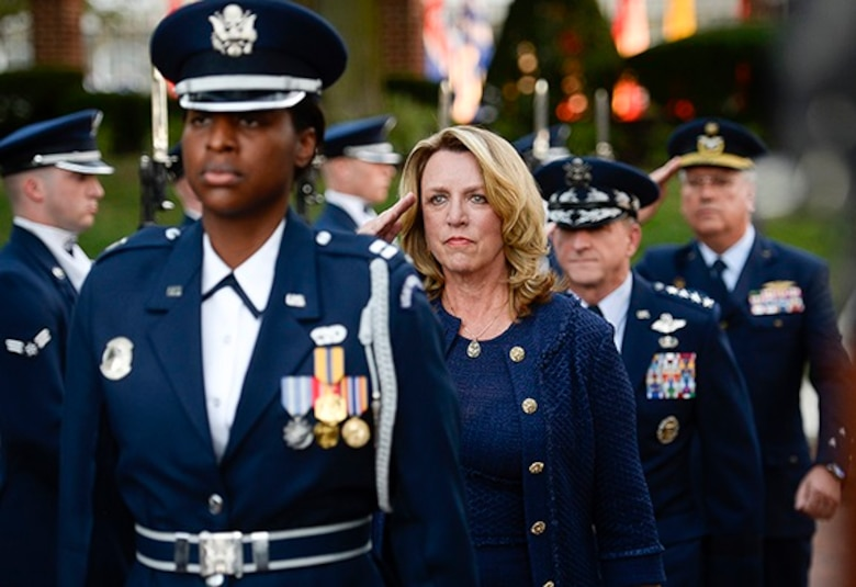 Secretary of the Air Force Deborah Lee James and Chief of Staff of the U.S. Air Force Gen. David L. Goldfein  arrive with the U.S. Air Force Honor Guard during the Air Force Tattoo on the Joint Base Anacostia-Bolling Ceremonial Lawn, Washington, D.C., Sept. 22.Airmen from across the Air Force District of Washington commemorated the Air Force's 69th birthday with a Military Tattoo. (U.S. Air Force photo)