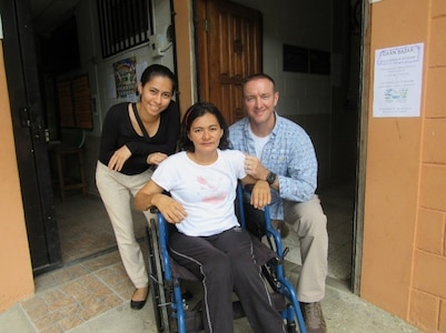 U.S. Army Maj. Jonathan Reagan, Joint Task Force Bravo Medical Element physical therapist, poses with one of the Honduran patients he provides care for during weekly visits to Centro de Rehabilitación Integral de Comayagua, August 3, 2016. This patient in particular inspired Reagan to begin a fundraiser to provide financial help to patients whose lives have been dramatically impacted by their injuries. (U.S. Army photo by 1st Lt Jenniffer Rodriguez)