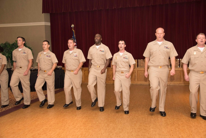 """Chief Petty Officer selectees sing """"Anchors Aweigh"""" during a promotion ceremony September 16, 2016. Fifteen Sailors from various units in South Carolina were presented with their new rank in a traditional ceremony at the Red Bank Club on Joint Base Charleston-Naval Weapons Station."""