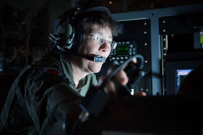 Lt. Col. Valerie Hendry, 53rd Weather Reconnaissance Squadron aerial reconnaissance weather officer instructs a new ARWO during the final flight of her career.(U.S. Air Force photo/Senior Airman Heather Heiney)