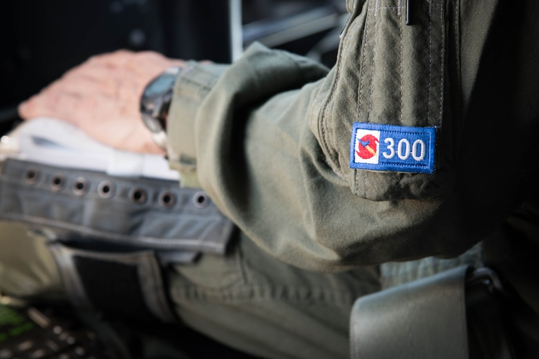 "Lt. Col. Troy ""Bear"" Anderson, 53rd Weather Reconnaissance Squadron pilot sits in the cockpit during the final flight of his Air Force career. The 300 on his uniform indicates the number of times he has penetrated the eye of a hurricane. (U.S. Air Force photo/Senior Airman Heather Heiney)"