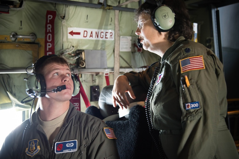 Lt. Col. Valarie Hendry, 53rd Weather Reconnaissance Squadron aerial reconnaissance weather officer, instructs new ARWO, 2nd Lt. Garrett Black, during the final flight of her Air Force Career. (U.S. Air Force photo/Senior Airman Heather Heiney)