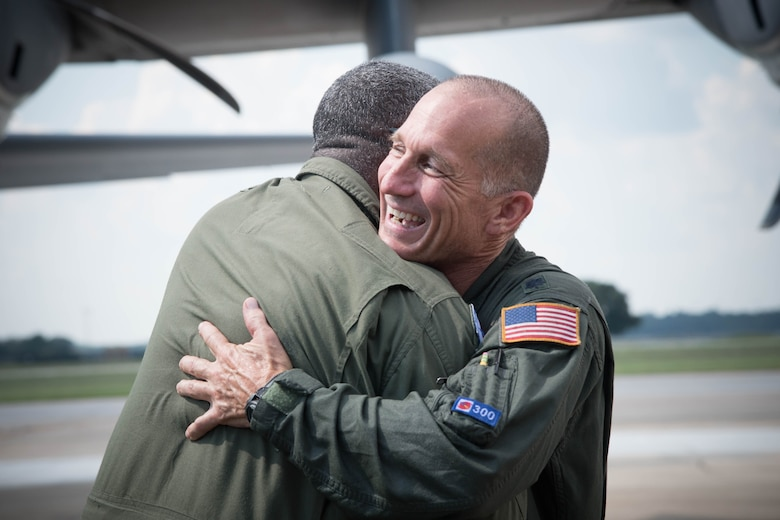 "Lt. Col. Troy ""Bear"" Anderson, 53rd Weather Reconnaissance Squadron pilot hugs, Master Sgt. Troy Bickham, 53rd WRS loadmaster, after the final flight of his Air Force career. (U.S. Air Force photo/Senior Airman Heather Heiney)"
