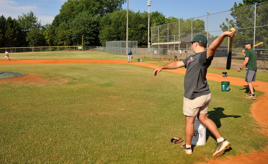 First Lt. Rick Hagauer, a 700th Airlift Squadron pilot, swings at a ball during baseball practice at Hembree Park in Roswell, Ga. on July 2, 2016. Hagauer has a long history of playing baseball that dates back to when he was an adolescent in Peachtree City. (U.S. Air Force photo by Senior Airman Andrew J. Park)