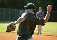 First Lt. Rick Hagauer, a 700th Airlift Squadron pilot, pitches a ball during baseball practice at Hembree Park in Roswell, Ga. on July 2, 2016. Hagauer has a long history of playing baseball that dates back to when he was an adolescent in Peachtree City. (U.S. Air Force photo by Senior Airman Andrew J. Park)