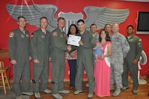 """Capt. Anthony Viccellio, 434th Flying Training Squadron Transition Flight chief (front center), accepts the """"XLer of the Week"""" award from Col. Thomas Shank (front left), 47th Flying Training Wing commander, on Laughlin Air Force Base, Texas, Sept. 22, 2016. The XLer is a weekly award chosen by wing leadership and is presented to those who consistently make outstanding contributions to their unit and Laughlin. (U.S. Air Force photo/1st Lt. Isabel Crump)"""