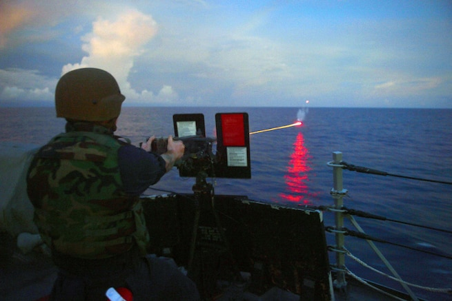 Navy Petty Officer 2nd Class Marcus Miller fires a .50-caliber machine gun during a live-fire exercise aboard the USS Momsen in the Philippine Sea, Sept. 28, 2016. The guided-missile destroyer is supporting maritime security and stability in the Indo-Asia-Pacific region. Navy photo by Chief Jay C. Pugh