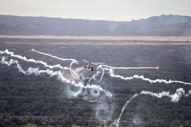 A UH-1Y Venom fires flares during Weapons and Tactics Instructor 1-17, an air support exercise, at Chocolate Mountain Aerial Gunnery Range, Calif., Sept. 28, 2016. Marine Aviation Weapons and Tactics Squadron 1 hosted the seven-week training event. Marine Corps photograph by Staff Sgt. Artur Shvartsberg