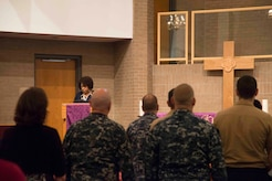 """Angela Cottman, staff member at Joint Base Charleston's Fleet and Family Support Center, addresses the audience at the inaugural """"Bells Across America"""" ceremony at All Saints Chapel on Joint Base Charleston-Naval Weapons Station September 22, 2016. Bells Across America is a ceremony that honors fallen servicemembers and is held each year on military installations around the world in conjunction with Gold Star Mothers and Families' Day."""