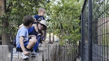 A father talks to his son while viewing an enclosure at the annual Zoo After Hours event at Alameda Park Zoo in Alamogordo, N.M. on Sept. 24, 2016. Zoo After Hours is a family-fun event that promotes family education. (U.S. Air Force photo by Airman 1st Class Alexis P. Docherty)
