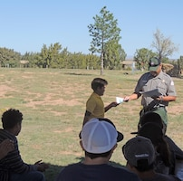SANTA ROSA LAKE, N.M., -- Santa Rosa park ranger Paul Sanchez gives a certificate of appreciation to one of the volunteers after the lake's National Public Lands Day event, Sept. 24, 2016.