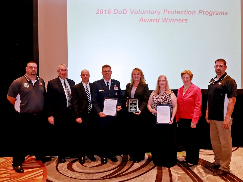 Representatives from the Ogden Air Logistics Complex accept the 2016 Department of Defense Voluntary Protection Program Group Achievement Award during the National Voluntary Protection Programs Participants' Association conference in Kissimmee, Florida. From the left are: William Hood, OO-ALC VPP Program Manager; Vance Lineberger, AFMC HQ/Safety; Len Litton, Director, Personnel Risk Reduction; Brig. Gen. Steven Bleymaier, Commander, Ogden Air Logistics Complex; Sandra Fitzgerald, Director, 309th Electronics Maintenance Group; Laura Haislip, 309th Electronics Maintenance Group Union Steward/Employee; Maureen Sullivan, Deputy Assistant Secretary of Defense, Environment, Safety and Occupational Health; and Joseph Blue, OO-ALC Union Safety/VPP Representative.