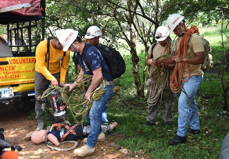 "Honduran PUMCIR (Personal Utilizado en Misiones Contra Incendio y Rescate – Personnel Used in Fire and Rescue) volunteers prepare the ropes, SCUBA tanks and ""Bartholomew"" the 50-pound dummy they would use to conduct cave extraction search and rescue training in the Comayagua National Park near El Volcan, Honduras, Sept. 24, 2016. A number of the PUMCIR members on this particular exercise were part of the PUMCIR ELITE-RESCUE team. (U.S. Air Force photo by Capt. David Liapis)"