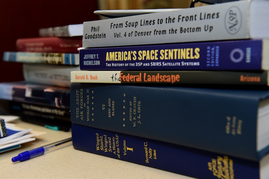 History books are displayed on the desk of Christopher McCune, 460th Space Wing historian, Sept. 26, 2016, at the 460th Space Wing Headquarters building on Buckley Air Force Base, Colo. McCune is responsible for providing the wing commander and the base community with special studies on various subjects that relate to the history of Buckley AFB and the 460th SW. (U.S. Air Force photo by Airman 1st Class Gabrielle Spradling/Released)