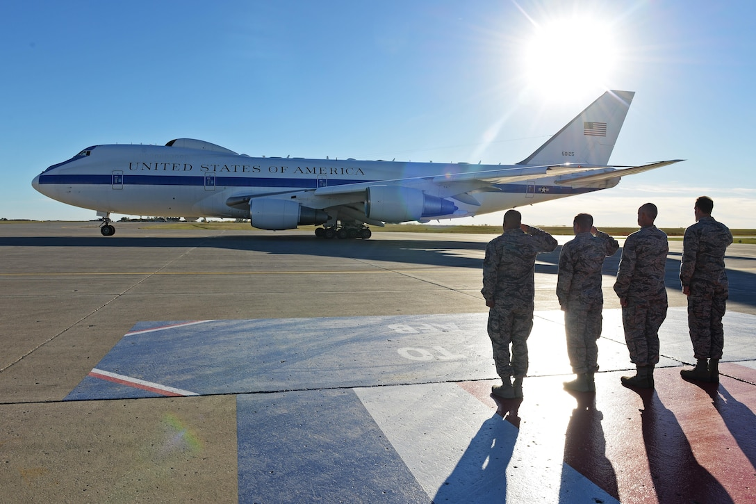 Base leaders salute Defense Secretary Ash Carter's aircraft at Minot Air Force Base, N.D., Sept. 26, 2016. Carter spoke with Airmen from the 5th Bomb and 91st Missile Wings and toured several facilities to include a missile alert facility and a B-52H Stratofortress static display. (U.S. Air Force photo/Airman 1st Class J.T. Armstrong)