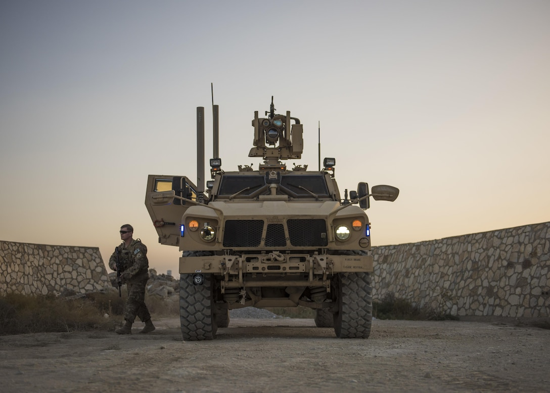 Senior Airman Michael Van Deusen, of the 455th Expeditionary Security Forces Squadron quick reaction force, gets out of a mine-resistant, ambush-protected vehicle during a patrol at Bagram Airfield, Afghanistan, Sept. 27, 2016. MRAPs are used by the 455th ESFS to secure the flightline. (U.S. Air Force photo/Senior Airman Justyn M. Freeman)