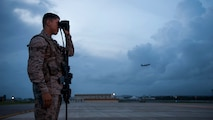 Airman 1st Class Jose Olivera, an 18th Security Forces Squadron response force member, scans the flightline with binoculars Sept. 27, 2016, at Kadena Air Base, Japan. By maintaining constant watch over flightline assets, Olivera helps prevent unauthorized activity from hindering aircraft operations. (U.S. Air Force photo/Senior Airman Peter Reft)