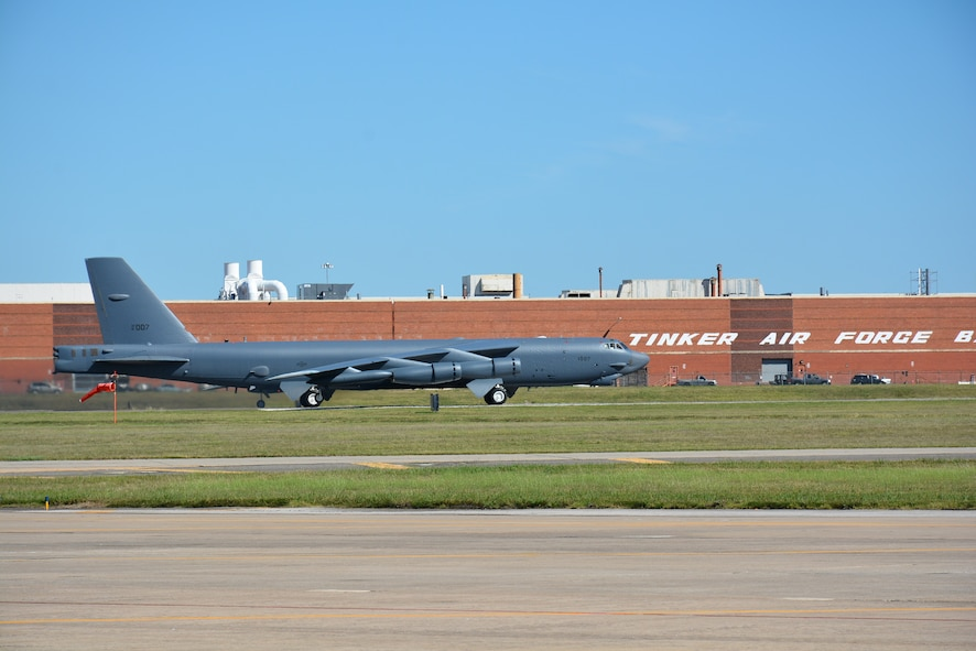 """""""Ghost Rider,"""" passes by Bldg. 3001 before taking off for Minot Air Force Base, N.D., where it will rejoin the B-52H fleet. After undergoing a nine-month overhaul and upgrade by the Oklahoma City Air Logistics Complex, 61-007 left Tinker Air Force Base Sept. 27. The historic aircraft is the first B-52H to ever be regenerated from long-term storage with the 309th Aerospace Maintenance and Regeneration Group at Davis-Monthan AFB, Ariz., and returned to full operational flying status. (Air Force photo by Darren D. Heusel)"""