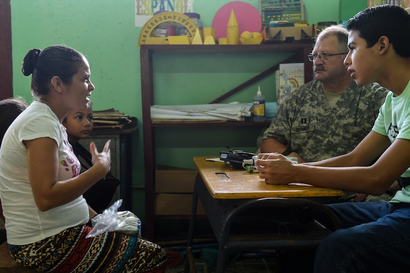 Members of the screening section listen to patient Rosa Chirinos during a medical readiness training exercise, or MEDRETE, in the village of Bacadilla, Olancho district, Honduras, Sept. 22, 2016. Chirinos, and her two young daughters, traveled almost two hours – 30 minutes on foot – to reach the MEDRETE site.