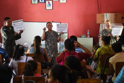 U.S. Army Staff Sgt. Lisa Kent, Joint Task Force-Bravo Medical Element veterinary food inspection specialist, begins a preventive medicine briefing during a medical readiness training exercise, or MEDRETE, in the village of Bacadilla, Olancho district, Honduras, Sept. 22, 2016. During the preventive medicine class, patients learn about the importance of different preventative health aspects, and receive vitamins and soap.