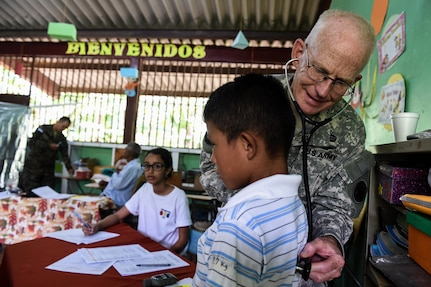 U.S. Army Lt. Col. (Dr.) Robert Walkup, Joint Task Force-Bravo Medical Element physician, listens to a patient's heartbeat during a medical readiness training exercise, or MEDRETE, in the village of Bacadilla, Olancho district, Honduras, Sept. 22, 2016. This is Walkup's second tour of duty in Honduras and the doctor said he would love to come for a third, because of missions like the Olancho MEDRETE.