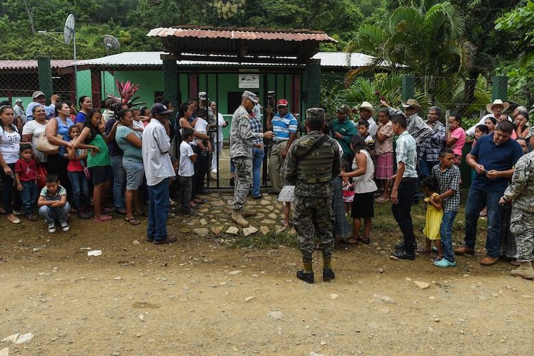 Members of the Joint Task Force-Bravo Joint Security Forces and Honduran military provide crowd control during a medical readiness training exercise, or MEDRETE, in the village of Bacadilla, Olancho district, Honduras, Sept. 23, 2016. The JSF and Honduran security personnel handled security issues throughout the two-day MEDRETE, and ensured the safety of the patients and the entire MEDEL team.