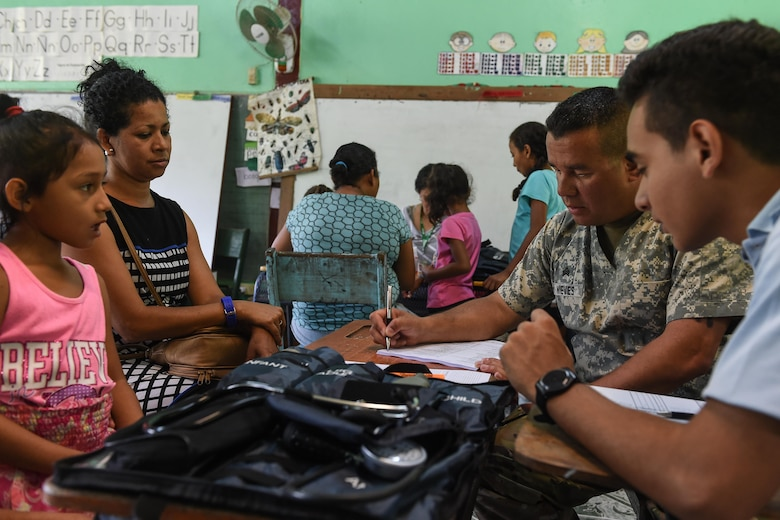 U.S. Army Sgt. Hiram Nieves Jr., Joint Task Force-Bravo Medical Element health care specialist, speaks to patients in the screening section during a medical readiness training exercise, or MEDRETE, in the village of Bacadilla, Olancho district, Honduras, Sept. 23, 2016. After attending the preventive medicine class, patients could receive a consultation from the medical screeners.