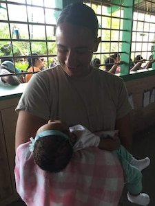 U.S. Army 1st Lt. Jenniffer Rodriguez, Joint Task Force-Bravo Medical Element medical surgical nurse and officer in-charge of the Olancho MEDRETE (medical readiness training exercise) holds and smiles at a baby during a MEDRETE in the village of Bacadilla, Olancho district, Honduras, Sept. 22, 2016. JTF-Bravo has been conducting MEDRETEs throughout Central America since 1993 to provide a variety of medical services to the local populations who otherwise would be unable to receive medical care from licensed providers.