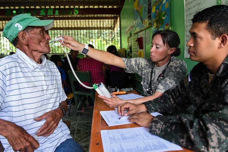 U.S. Army Sgt. Yanna Ramaekers, Joint Task Force-Bravo Medical Element health care specialist, takes a patient's temperature reading during a medical readiness training exercise, or MEDRETE, in the village of Bacadilla, Olancho district, Honduras, Sept. 22, 2016. Members of the Honduran military and local civilians volunteered their time to translate for the JTF-Bravo MEDEL team.