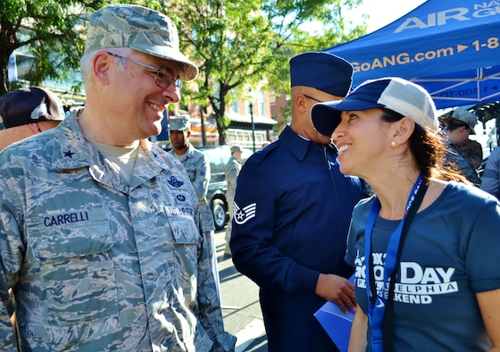 The Adjutant General of the Pennsylvania National Guard Brig. Gen. Tony Carrelli talks to Jodi Harris, FOX 29 planning manager for FOX News, during the FOX 29 Salutes the Military event Sept. 23, 2016 in center city Philadelphia.  For nearly a decade, the FOX News affiliate has held the event devoted to recognizing and thanking service members. (U.S. Air National Guard photo by Tech. Sgt. Andria Allmond)