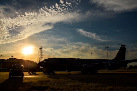 The sun rises over a KC-135R Stratotanker from the 117th Air Refueling Wing as crew members conduct a pre-flight meeting at RAF Mildenhall, England, Aug. 24, 2016. (U.S. Air National Guard photo by: Senior Airman Wesley Jones)