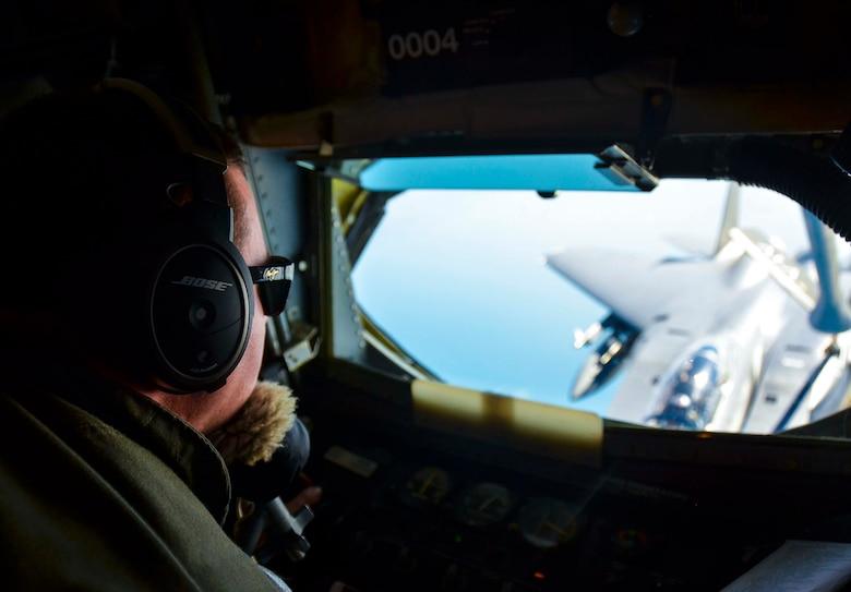 An F-15E Strike Eagle, 494th Fighter Squadron, RAF Lakenheath, England is refueled by a KC-135R Stratotanker, 117th Air Refueling Wing, Birmingham, Ala., Aug. 24, 2016, over the Atlantic Ocean. (U.S. Air National Guard photo by: Senior Airman Wesley Jones)