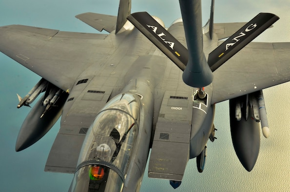 An F-15E Strike Eagle, 494th Fighter Squadron, RAF Lakenheath, England is refueled by a KC-135R Stratotanker, 117th Air Refueling Wing, Birmingham, Ala., Aug. 24, 2016, over the Atlantic Ocean. (U.S. Air National Guard photo by: Senior Airman Wesley Jones)