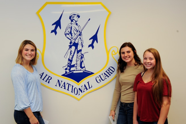 160927-Z-RD118-005 – Isabella Lapinta (left), Emily Russo (center), and Melissa Aliotta (right) of Lakeshore High School become the newest members of the Michigan Air National Guard during a ceremony on Sept.27, 2016 at Selfridge Air National Guard Base, Mi. (US Air National Guard Photo by John Brandenburg)