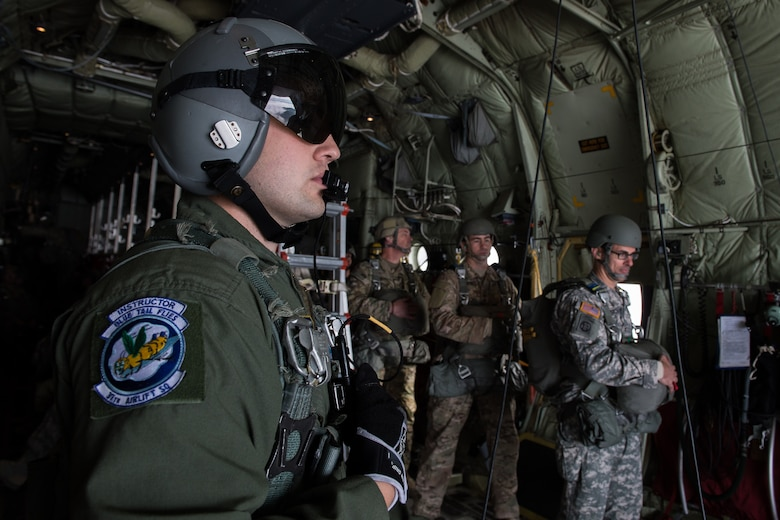 Senior Airman Anthony Oldham, 37th Airlift Squadron loadmaster, prepares Soldiers to jump from a C-130J Hercules over the skies of Germany, Sept. 21, 2016. Oldham saved the life of a local civilian while on temporary assignment to Poland by pinching off the man's jugular vein, Oct. 17, 2015. (U.S. Air Force photo by Senior Airman Nesha Humes)