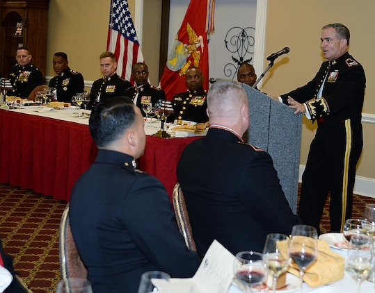 Retired Marine Col. Dan Gillan, (right) president and president and chief executive officer, Albany Area Young Men's Christian Association, Albany, Ga., and the guest of honor at a recent mess night, spoke to the Marines about the importance of volunteerism at the Town and Country Grand Ballroom aboard Marine Corps Logistics Base Albany.