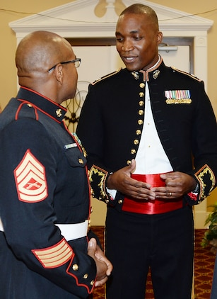 Lieutenant Col. Nathaniel K. Robinson, right, president of the mess, goes over the final details of the mess night with Gunnery Sgt. David Washington, vice president of the mess, at the Town and Country Grand Ballroom aboard Marine Corps Logistics Base Albany, recently.
