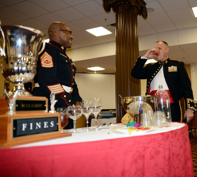 """Marines bring attention to infractions, and sometimes false allegations, adding humor to a recent mess night held at Marine Corps Logistics Base Albany's Town and Country Grand Ballroom.  Marines found guilty were charged to pay a small fine or take a drink from the """"grog."""""""
