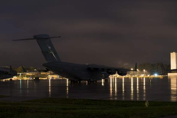 POPE FIELD, N.C. -- A C-17 Globemaster III from Joint Base Lewis-McChord, Washington, sits on Green Ramp here early Sept. 29 during a storm which dumped more than nine inches of rain on the base in two days, resulting in flooding and washed out roads around the installation. Crews from McChord and other Air Mobility Command bases rode out the storm while waiting to resume operations during Large Package Week, a quarterly exercise which provides vital airlift training for Air Force crews from Pope and AMC bases nationwide, and for Fort Bragg Army paratroopers and support units. (U.S. Air Force photo/Marc Barnes)