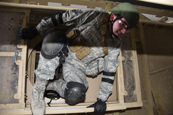 Tech. Sgt. Thomas Bryan, a 5th Combat Communications Group Combat Readiness School student exits a vehicle rollover trainer at Moody Air Force Base, Georgia. (U.S. Air Force photo by Ed Aspera)