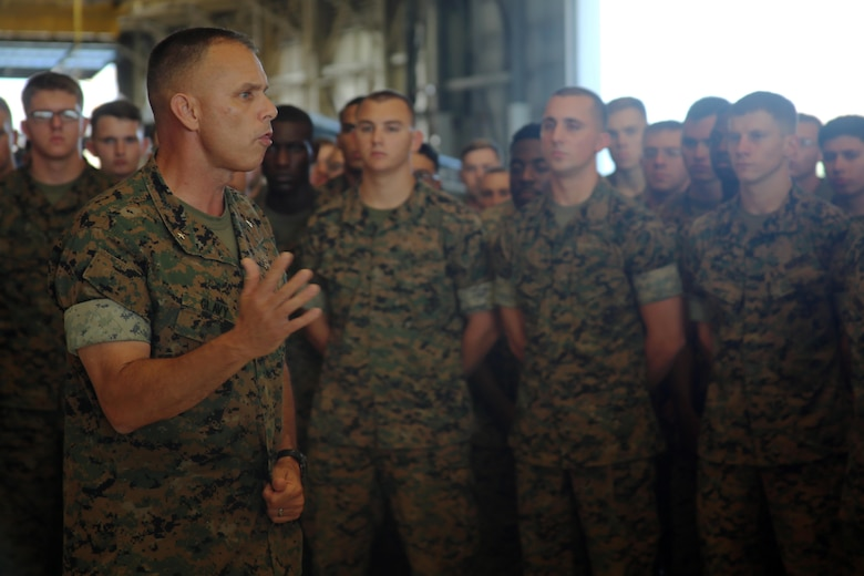 Brig. Gen. Matthew Glavy addresses Marines with Marine Attack Squadron 231 during a pre-deployment brief aboard Marine Corps Air Station Cherry Point, N.C., Sept. 28, 2016. The Marines took a brief pause as part of their pre-deployment preparations to receive a few words of encouragement from the commanding general. Glavy wished the Marines a safe journey as they are slated to continue training for their upcoming deployment in the fall. Glavy is the commanding general of 2nd Marine Aircraft Wing. (U.S. Marine Corps photo by Lance Cpl. Mackenzie Gibson/Released)
