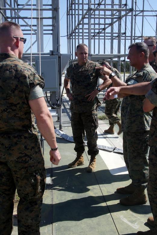 """Brig. Gen. Matthew Glavy listens to Marines from the outlying field working group discuss the expeditionary capabilities aboard Marine Corps Auxiliary Landing Field Bogue, N.C., Sept. 28, 2016. Glavy visited the airfield to thank Marines for their hard work, to better understand the challenges they overcome on a daily basis and set eyes on supporting facilities to ensure they are maintained to high standards. """"Bogue represents the 2nd Marine Aircraft Wing's ability to conduct expeditionary operations,"""" said Glavy. """"They provide aviation ground support, air traffic control, and operations support to the aircraft that rely on them. It is a unique place where 2nd MAW can get critical expeditionary training that we cannot receive anywhere else."""" Glavy is the commanding general for 2nd MAW. (U.S. Marine Corps photo by Lance Cpl. Mackenzie Gibson/Released)"""