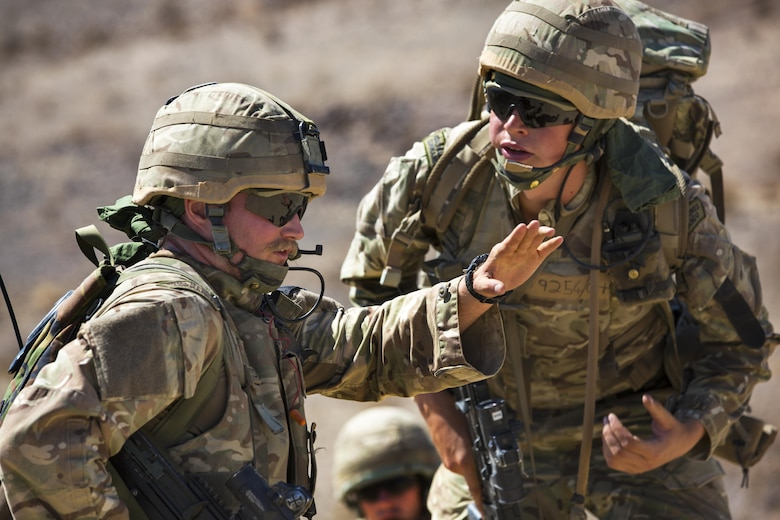 British Royal Marines discuss their scheme of maneuver during an assault on Range 205 as part of Exercise Black Alligator aboard the Marine Corps Air Ground Combat Center, Twentynine Palms, Calif., Sept. 13, 2016. U.S. and British Royal Marines conducted bilateral training in urban warfare maneuvers at Twentynine Palms, Calif. (U.S. Marine Corps photo by Cpl. Levi Schultz)