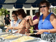 Food vendors serve ethnic food at the United States Air Force Special Operations School 2nd annual open house on Hurlburt Field, Fla., Sept. 30, 2016. (U.S. Air Force photo/Staff Sgt. Melanie Holochwost)