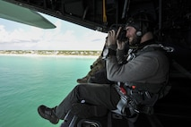 Jay Bennett, journalist and associate editor for Popular Mechanics, documents his flight on an MC-130 Combat Talon II in the Hurlburt Field, Fla., area Sept. 28, 2016. He embedded with Air Force Special Tactics to learn more about their mission. (U.S. Air Force photo/Airman 1st Class Joseph Pick)