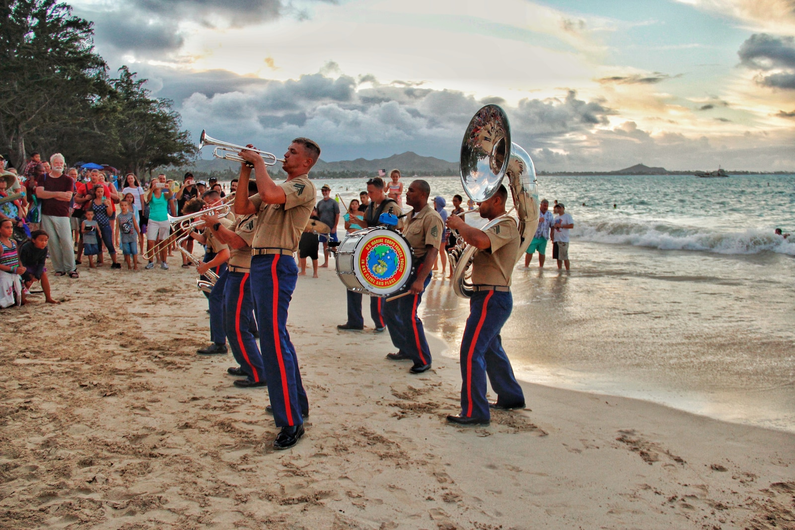 The MARFORPAC Brass Band performs in front of a crowd at Kailua Beach.