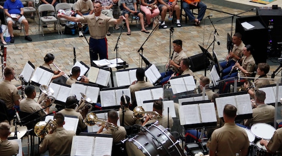 The MARFORPAC Band performs a Summer Concert, led by the Officer-In-Charge CWO3 Bryan Sherlock.