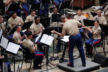 CWO3 Bryan Sherlock conducts the concert band during a performance in Kaneohe, Hawaii.